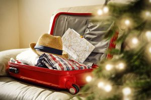 open suitcase with holiday lights